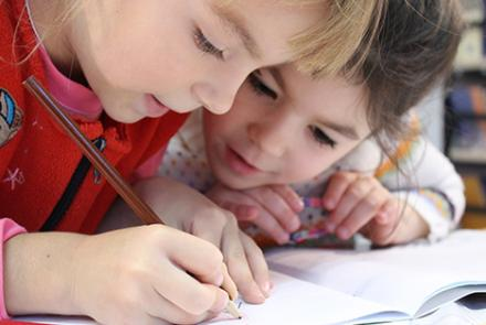 two young students writing