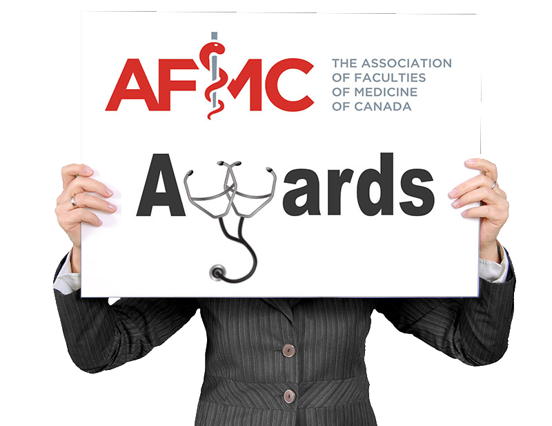 Woman holding banner that says AFMC awards